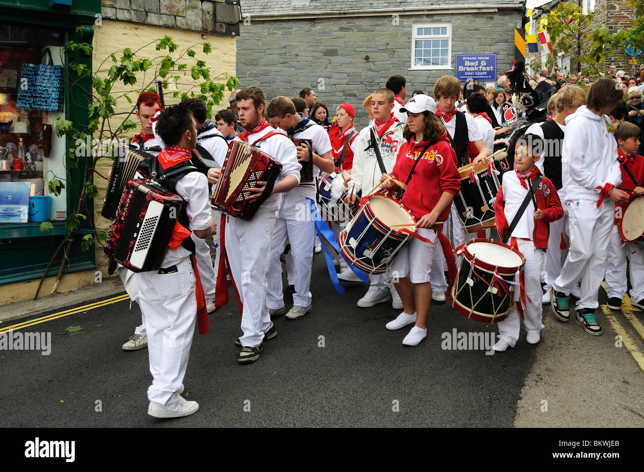 teenagers playing music and leading the parade on obby oss day in padstow, cornwall, uk - Stock Image