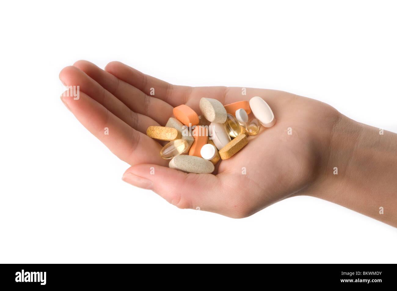 hand holding pills - Stock Image