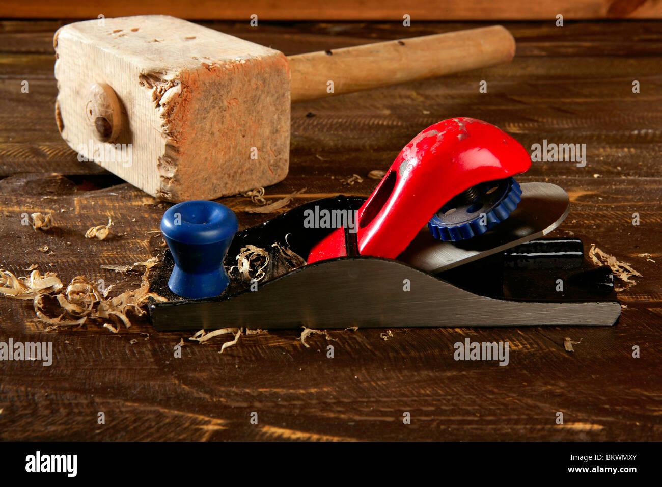 planer carpenter hand tool wood shaving over wooden board - Stock Image