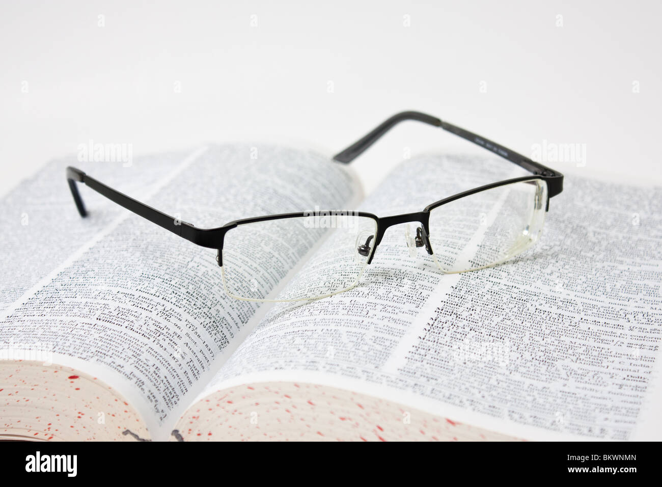 eyeglasses on dictionary - Stock Image