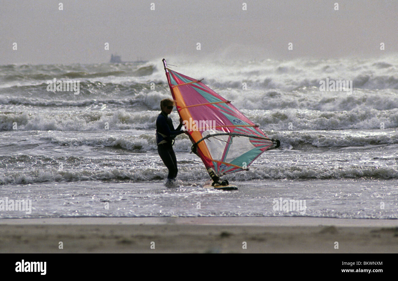 A windsurfer on a breezy day in Aransas Pass, Texas - Stock Image