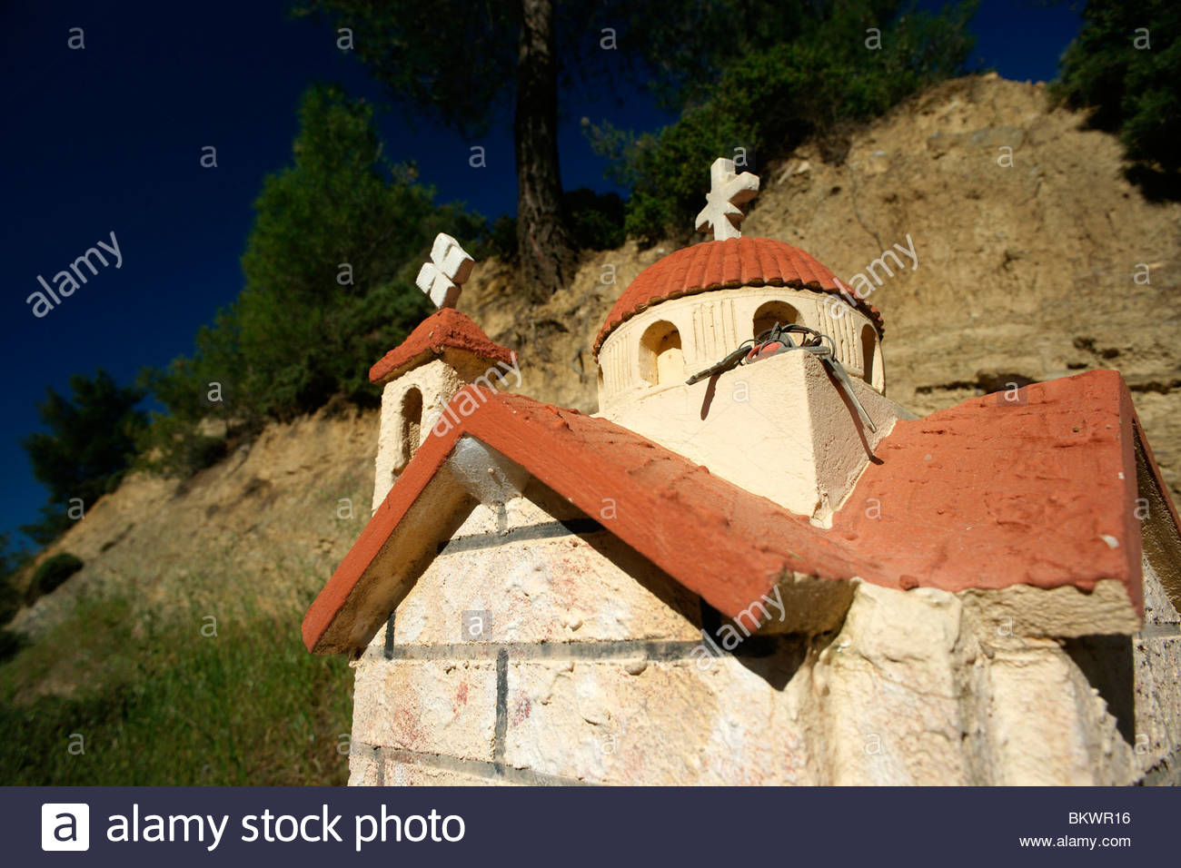 Miniature copy of a Greek church - in this instance used to mark the area of death Greece - Stock Image