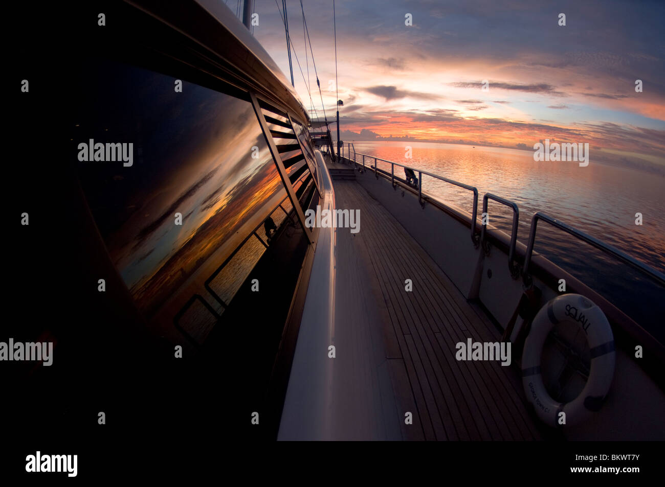Sunset over the yacht, SY Squall, Layang Layang, Sabah, Malaysia, Borneo - Stock Image