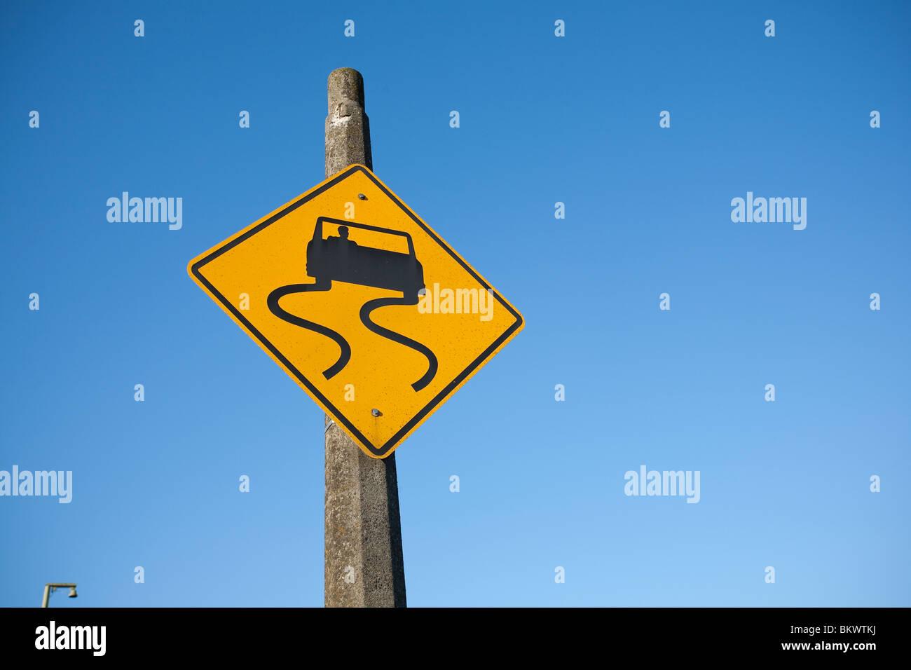 Slippery When Wet Traffic Warning Sign - South Park - Seattle, Washington - Stock Image