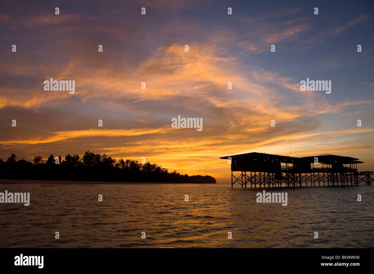 Sunset over Mari Mari Dive Lodge, Kecil Island, Mantanani, South China Sea, Sabah, East Malaysia. - Stock Image