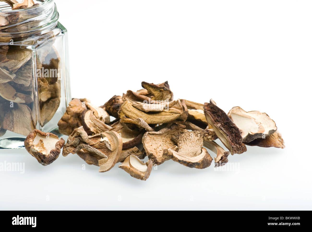Porcini Mushrooms And Jar On White Background - Stock Image