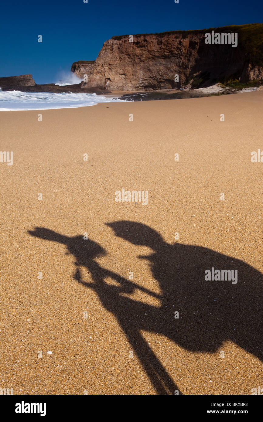 The shadow of a photographer at Panther beach in California, USA - Stock Image