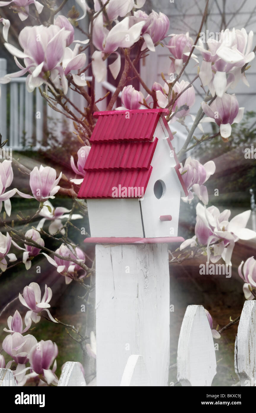Zoom Effect Bird House on White Pickett Fence in Concord, North Carolina - Stock Image