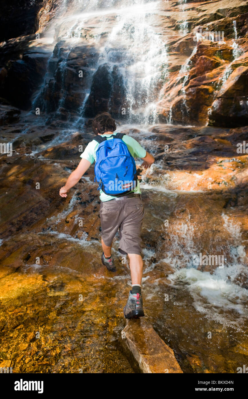 A man hiking at Arethusa Falls in Crawford Notch State Park in New Hampshire's White Mountains. Stock Photo