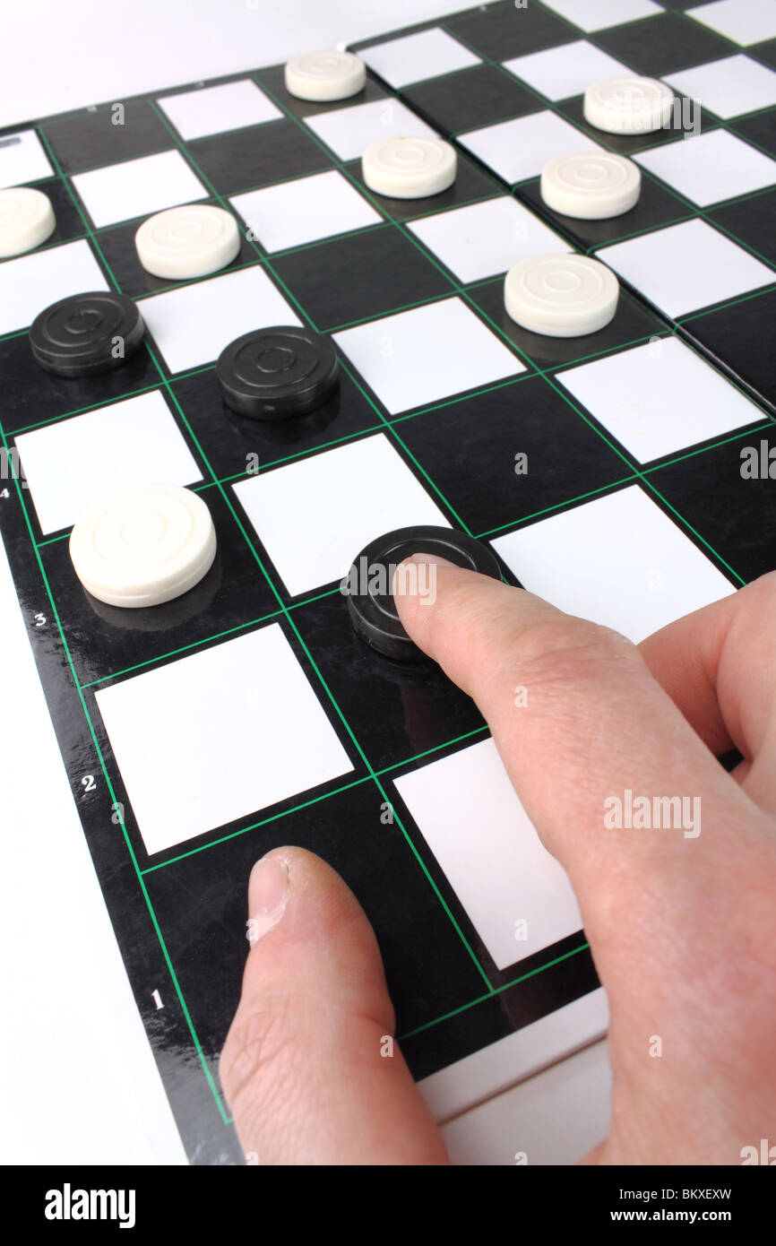 playing a game of draughts - Stock Image