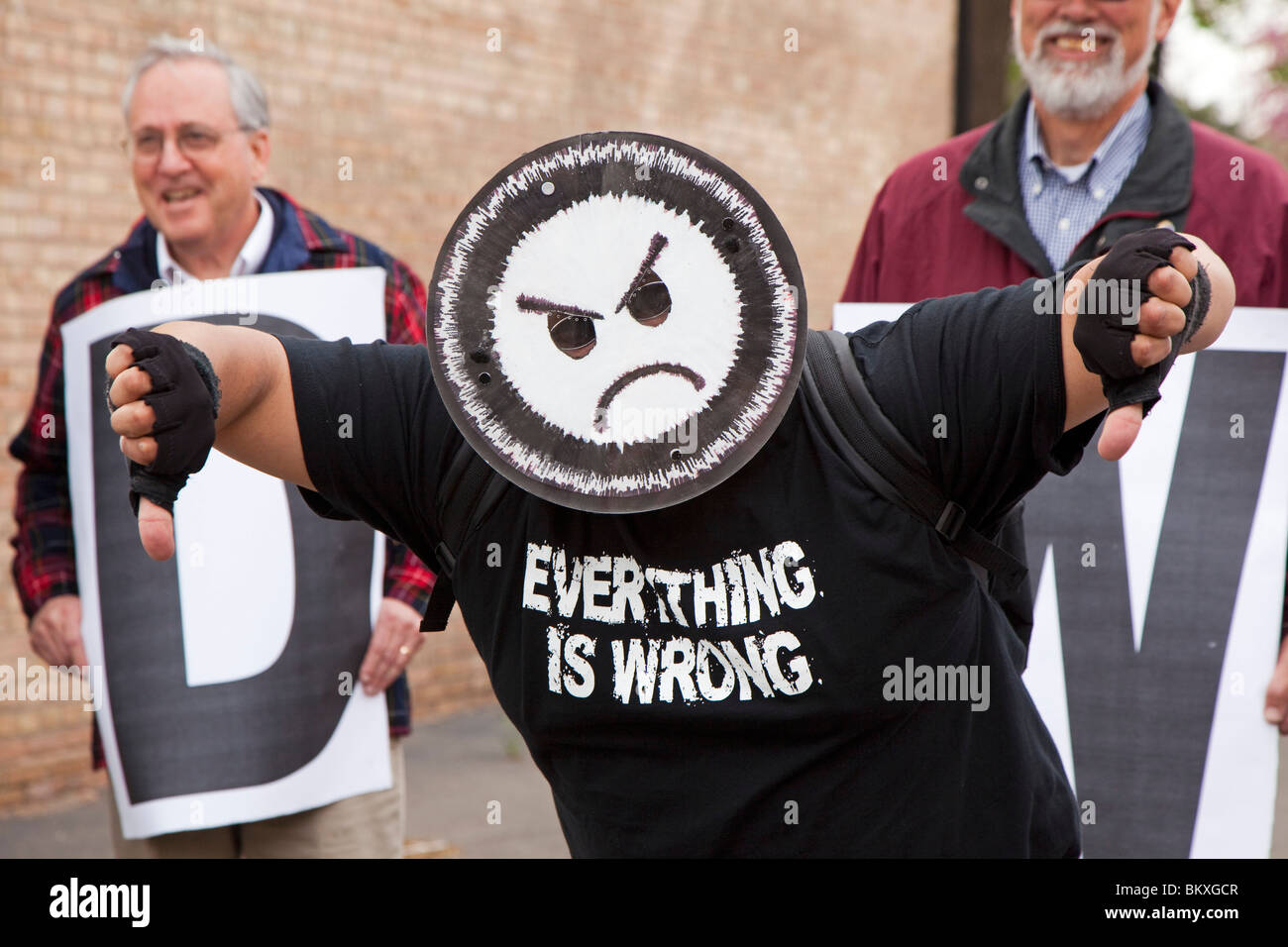 Dearborn, Michigan - A man on a labor picket line wears an unhappy face and the slogan 'Everything is Wrong.' - Stock Image