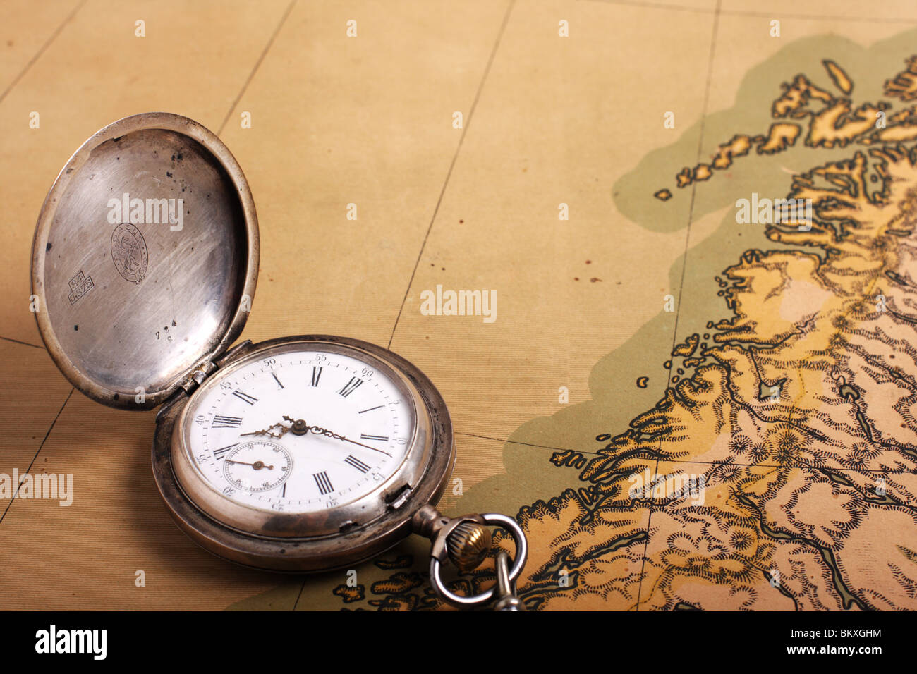 Clock old map stock photos clock old map stock images alamy old silver pocket watch on ancient map stock image gumiabroncs Image collections
