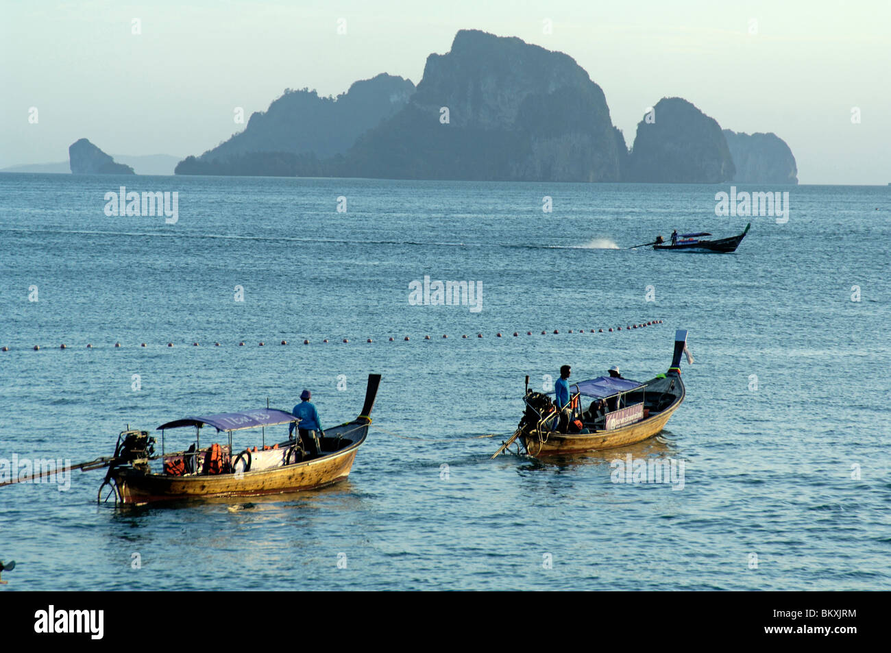 Three boat on Krabi beach at Thailand ; South East Asia - Stock Image