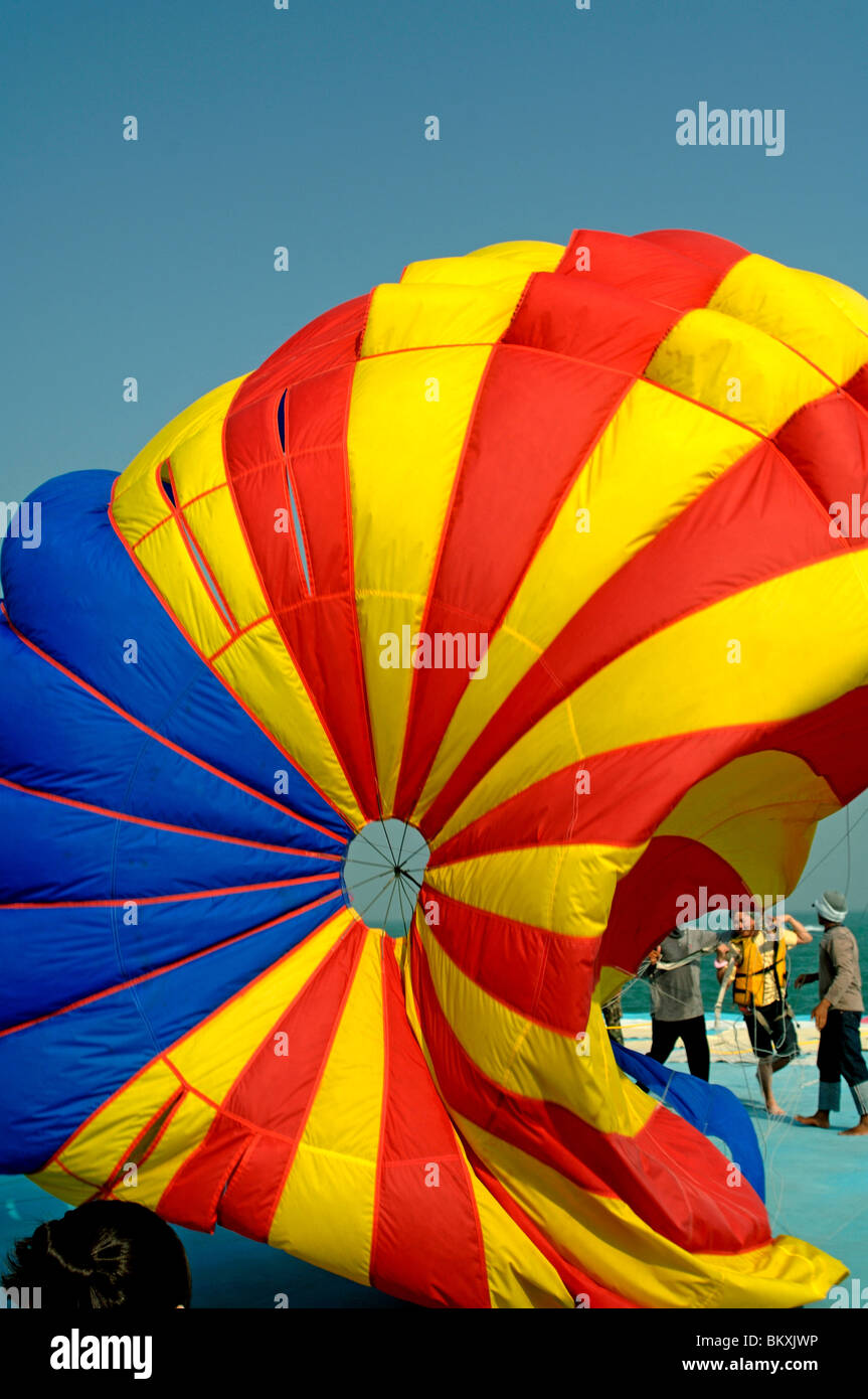 Tricolor Parasailing water sports at Pattaya ; Thailand ; South East Asia - Stock Image