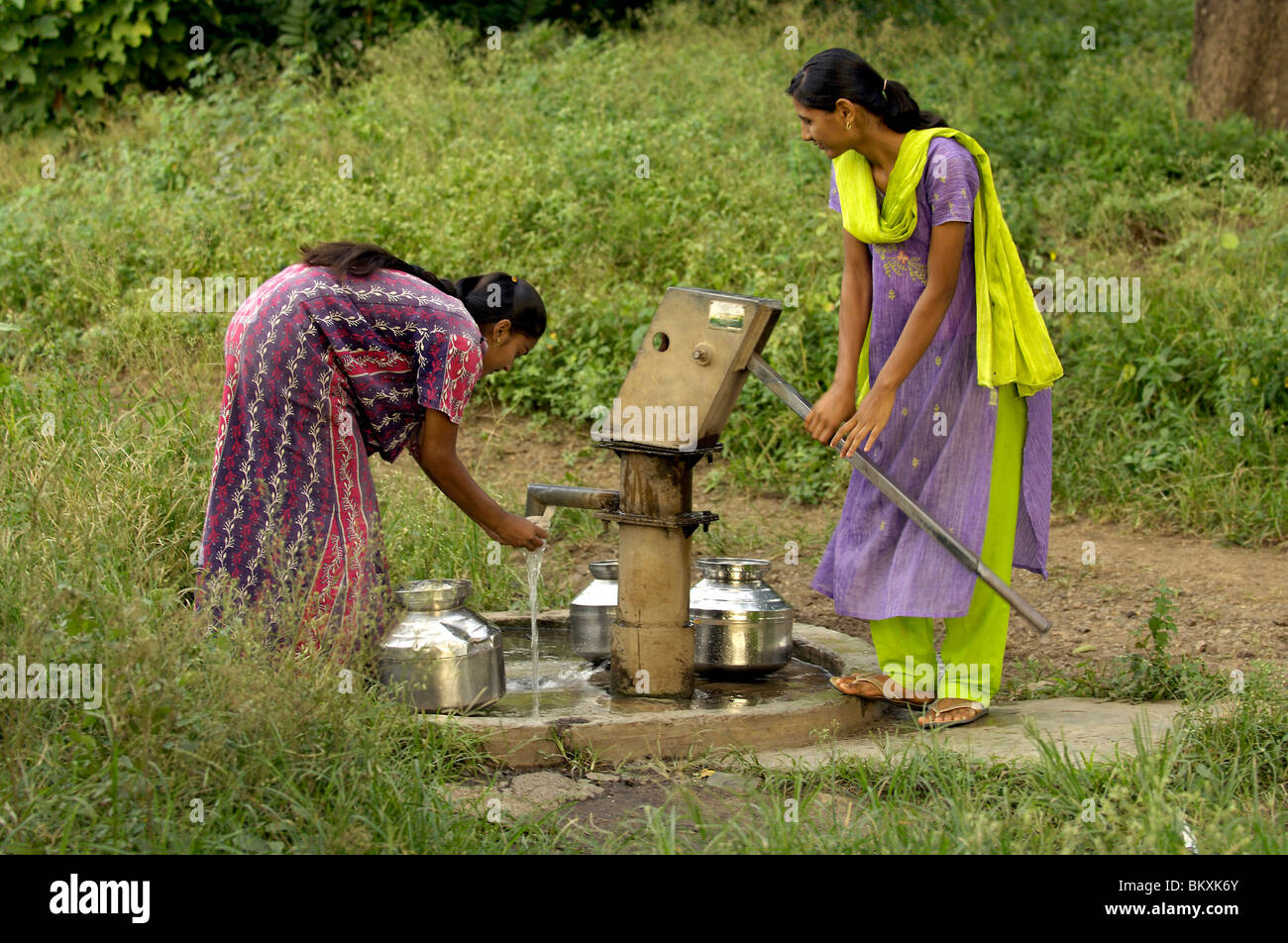 Two women at bore well for drinking water at Ralegan Siddhi near Pune ;  Maharashtra ;