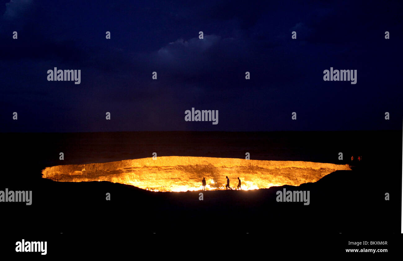 Derweze or Darvaza, aka as the Door to Hell is a huge crater of burning natural gas in the Kara-kum desert in Turkmenistan. - Stock Image