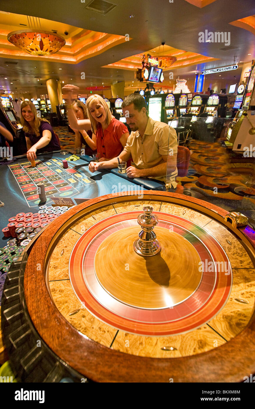 Scene on gaming floor of casino - excited players bet as roulette wheel spins, South Lake Tahoe, Nevada, USA. - Stock Image