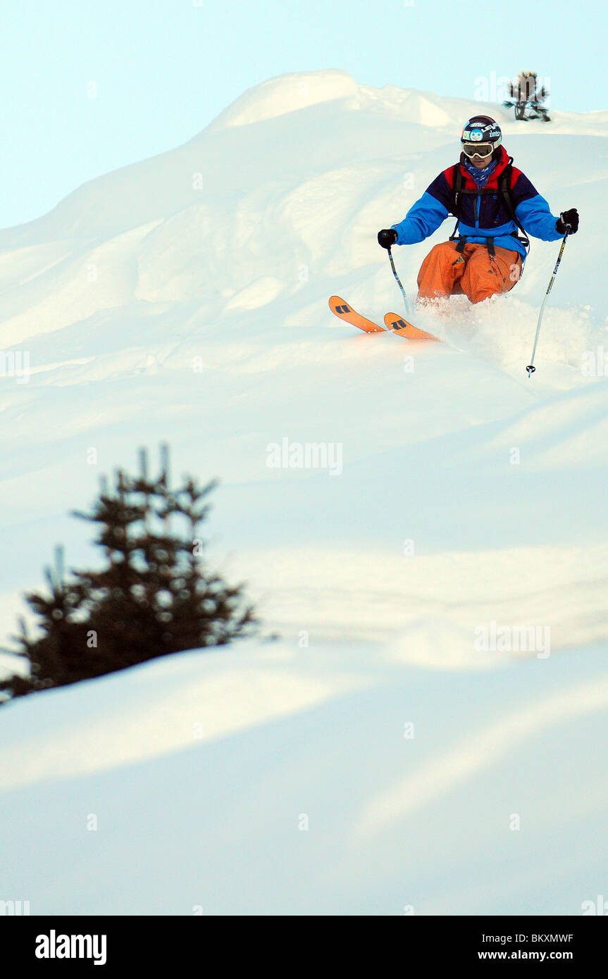 A skier off-piste in the French ski resort of Courchevel. - Stock Image