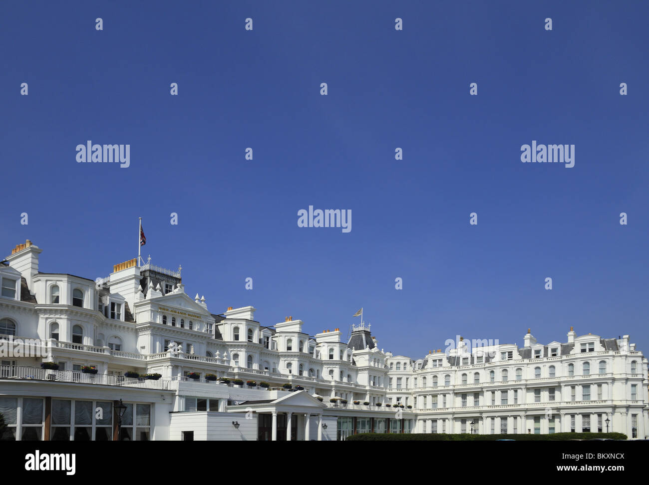 The facade of the five star Grand Hotel on Eastbourne's seafront, East Sussex. - Stock Image