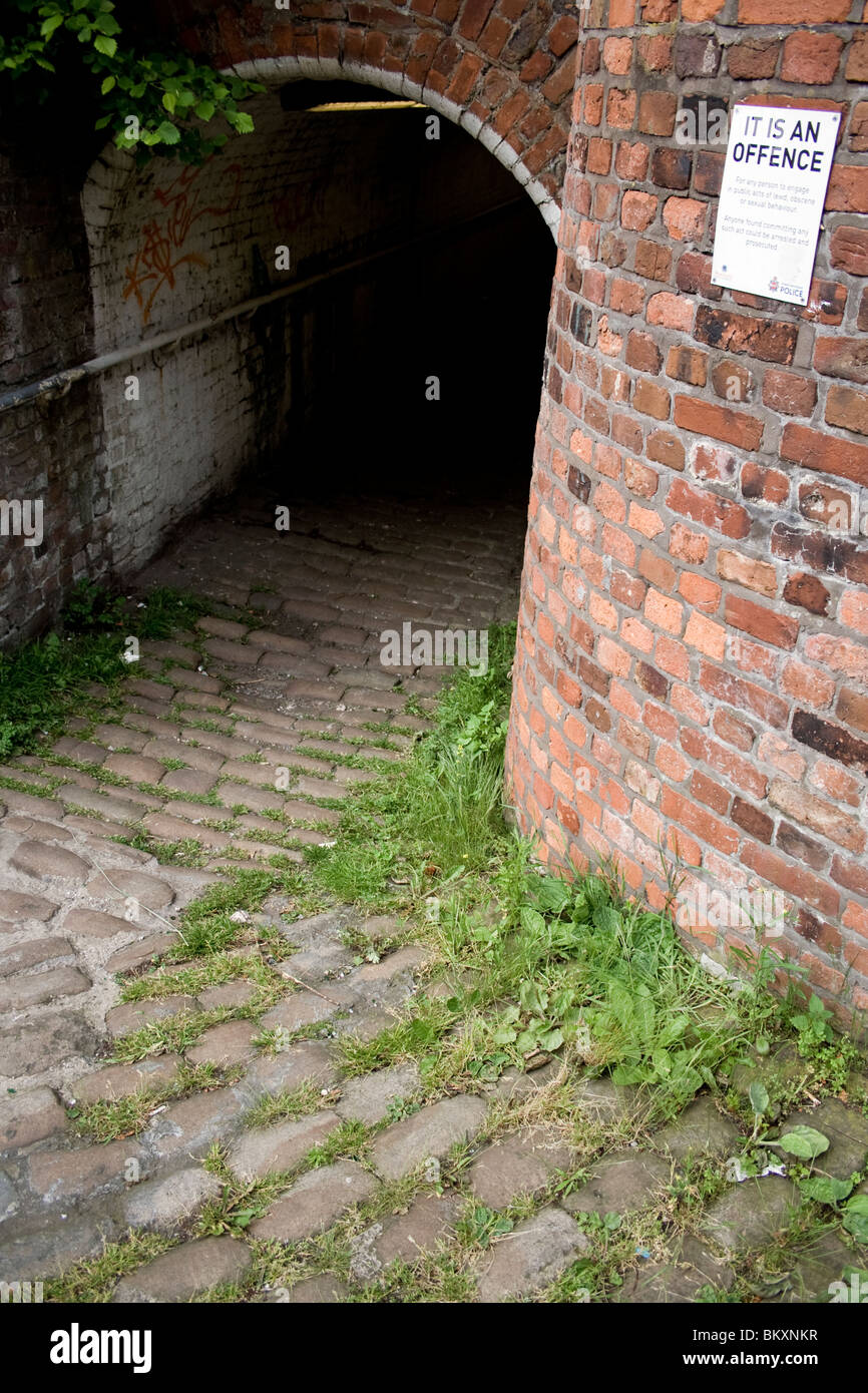 An underpass under a bridge along the canal to the east of Manchester heading towards Ancoats. It is an offense. - Stock Image