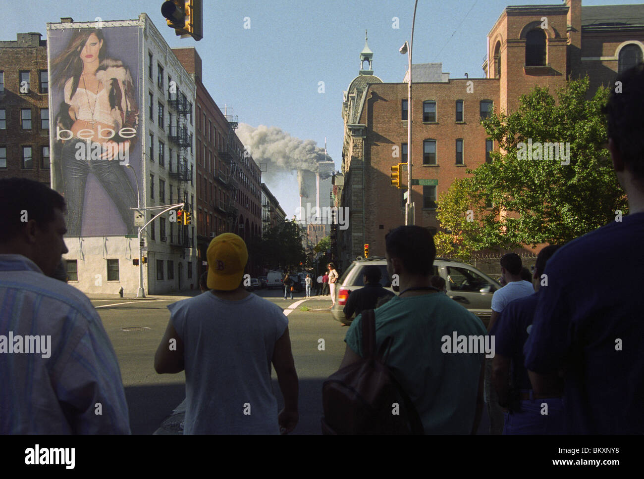 d0cd7a765e75 New Yorkers watch the twin towers of the World Trade Center burn from  Houston   Thompson Streets. ©Stacy Walsh Rosenstock Alamy