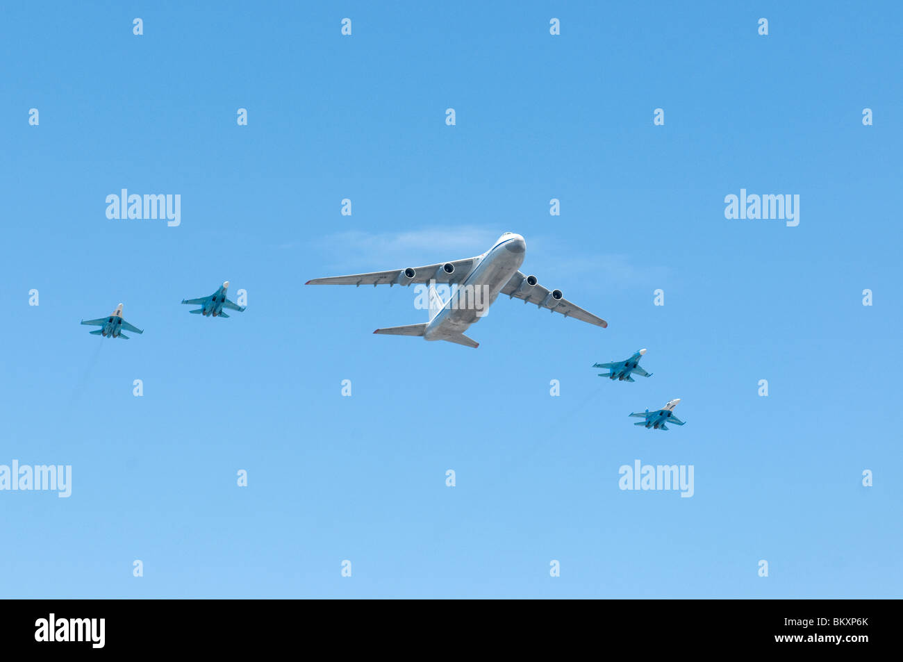 Russian air force Antonov An 124 and 4xSukhoi Su 27 fly over the Red Square on Moscow Victory Parade of 2010 - Stock Image