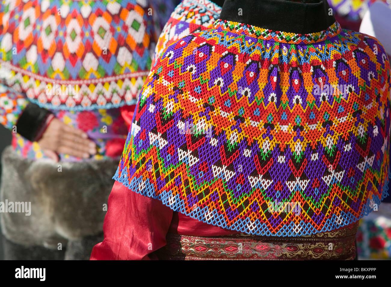 Inuit women wearing traditional Greenlandic national costume or Kalaallisuut in Ilulissat on Greenland. - Stock Image