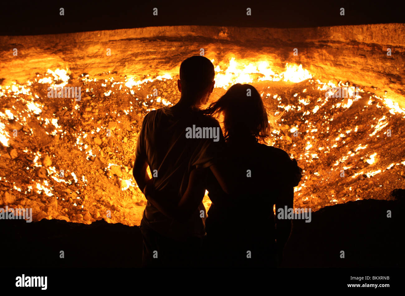 Derweze or Darvaza, aka as the Door to Hell is a huge crater of burning natural gas in the Kara-kum desert in Turkmenistan. Stock Photo