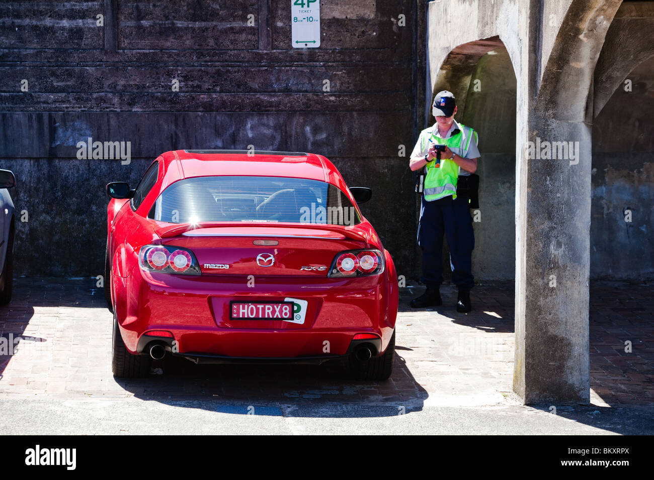 Mazda RX8 being booked for overstaying parking - Stock Image
