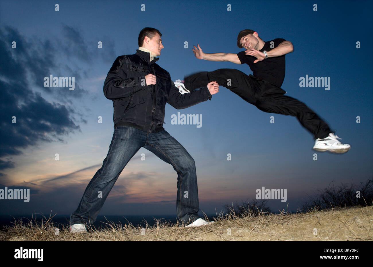 karate training by sunset - Stock Image