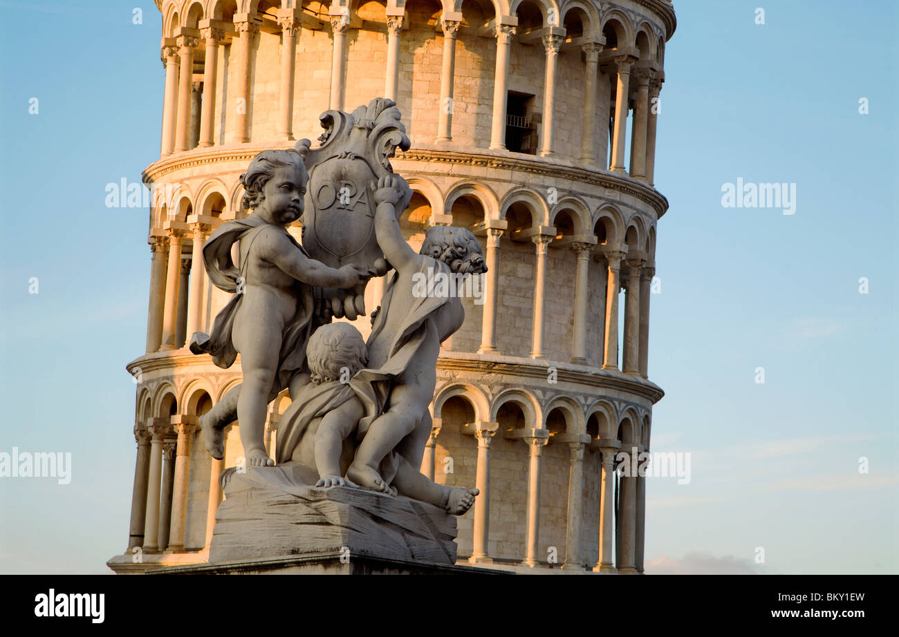 Pisa - angles sculpture and hanging tower in evening light - Stock Image