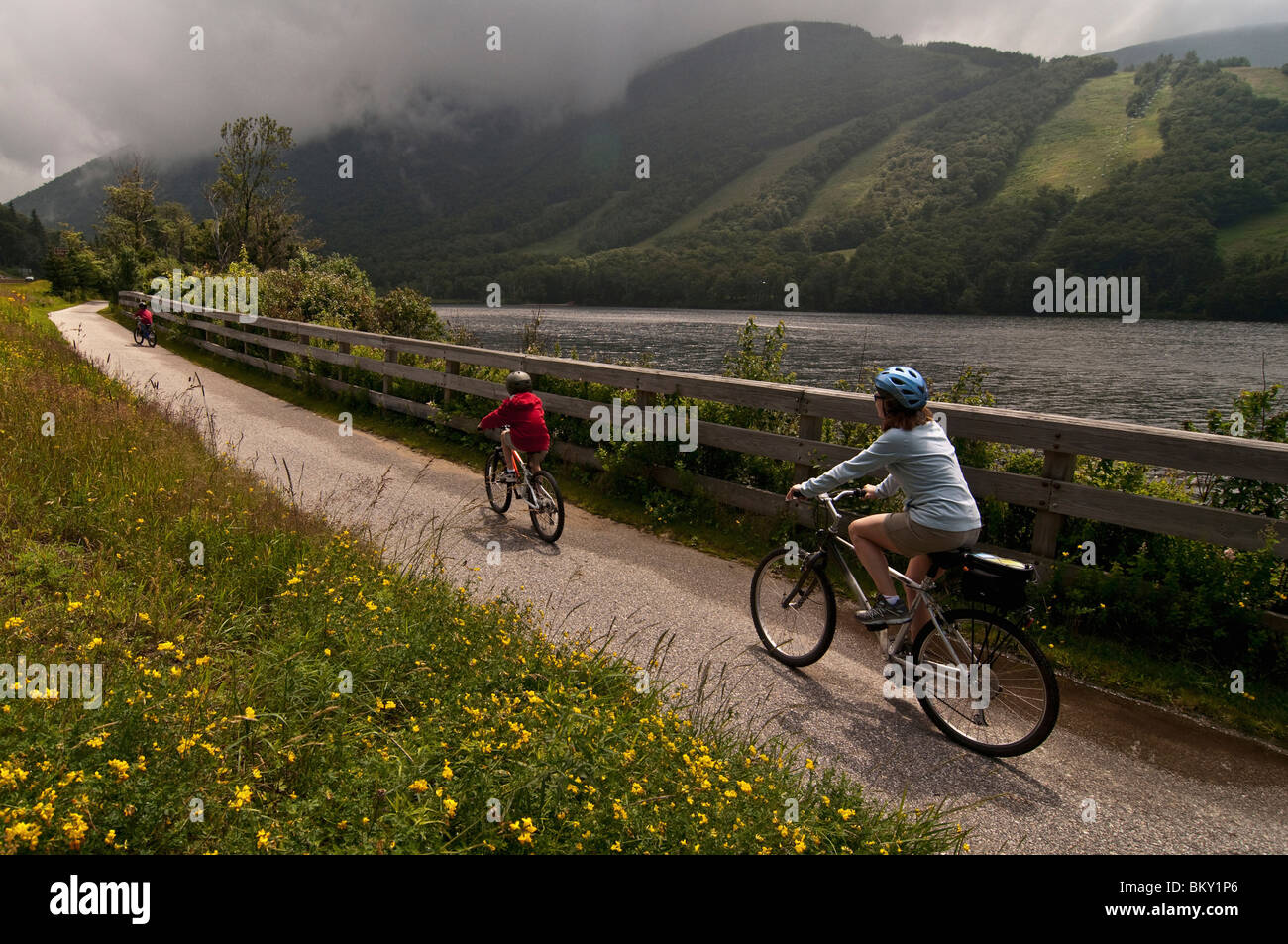 Mom and son biking along the Franconia Notch Bike Trail. Stock Photo