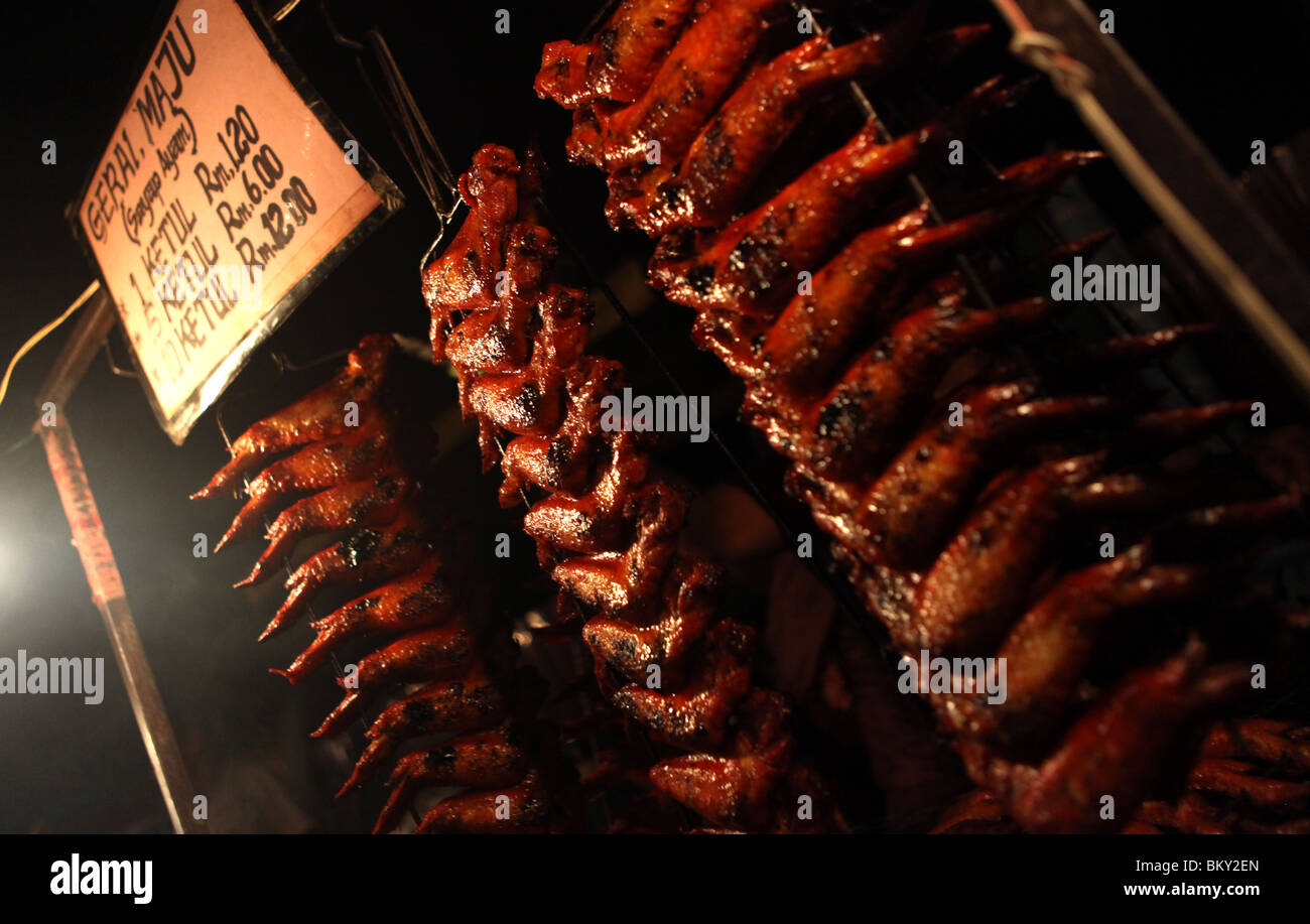 Barbecued chicken wings on display at the night market in Kota Kinabalu, Sabah state, Borneo in Malaysia. - Stock Image
