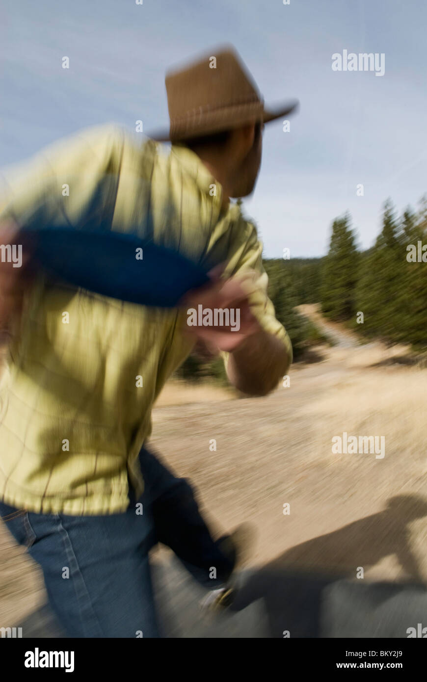 Teeing off on a par 3, a young man prepares to throw a disk during a game of disc golf in Lake Tahoe, California. - Stock Image