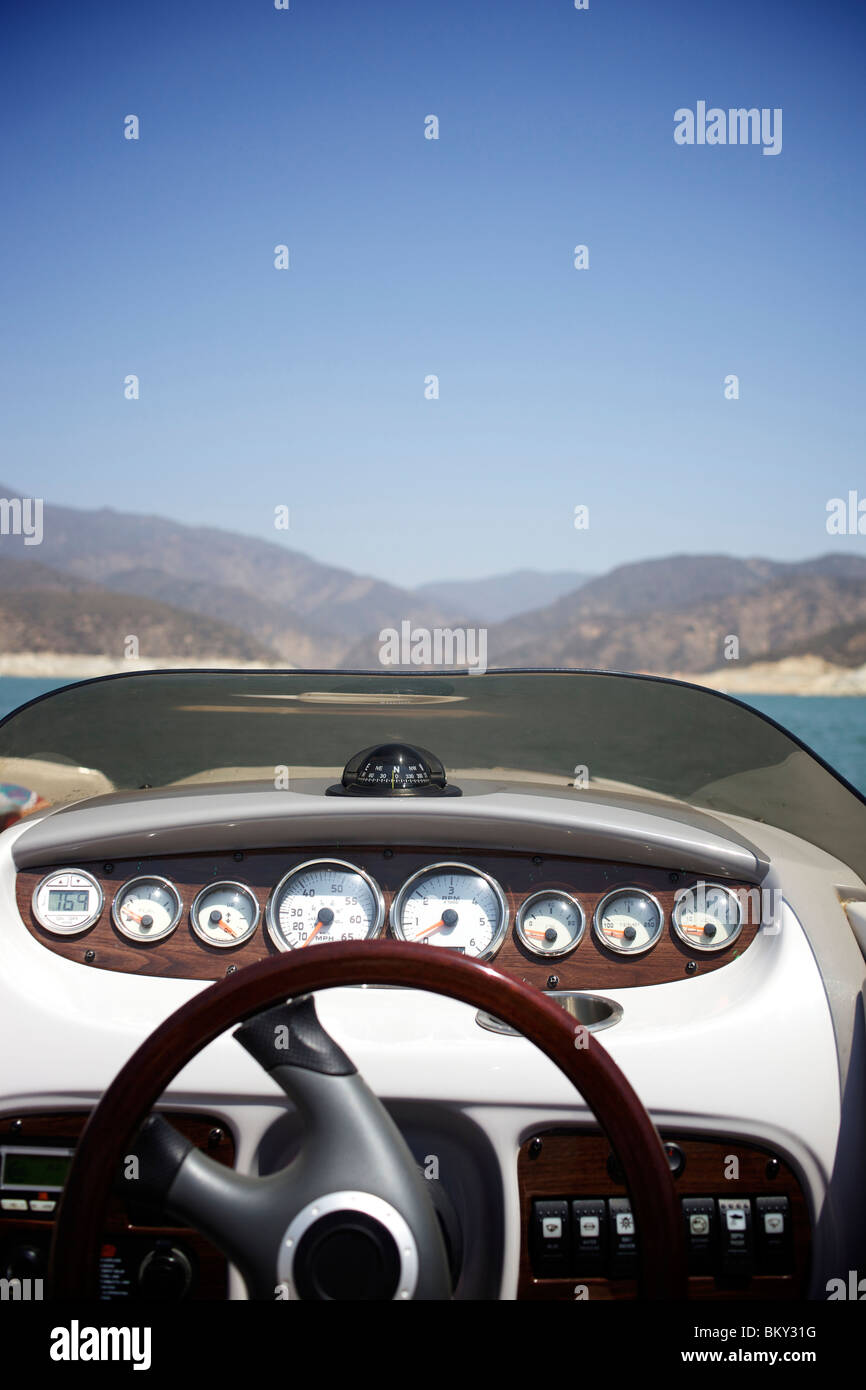 Steering wheel of a wakeboarding boat at Castaic Lake, Santa Clarita, California. - Stock Image