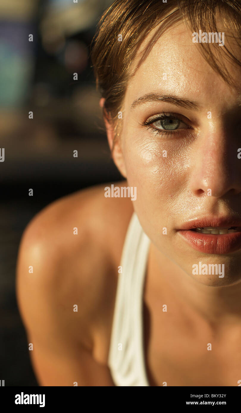 Close up shot of a runner's face looking straight at the camera in San Diego, California. - Stock Image