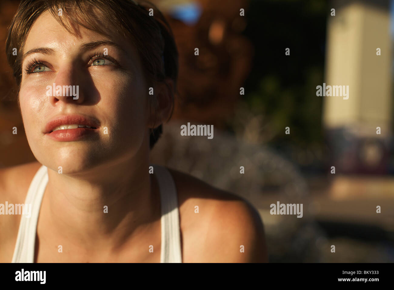Portrait of a female runner looking away from the camera in San Diego, California. - Stock Image