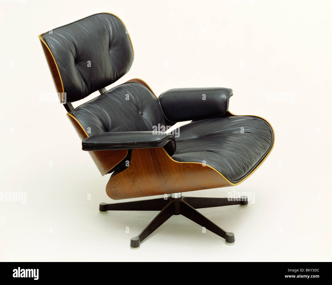 Armchair and footstool Model Ottoman 671, by Charles and Ray Eames. US, 1955 Stock Photo