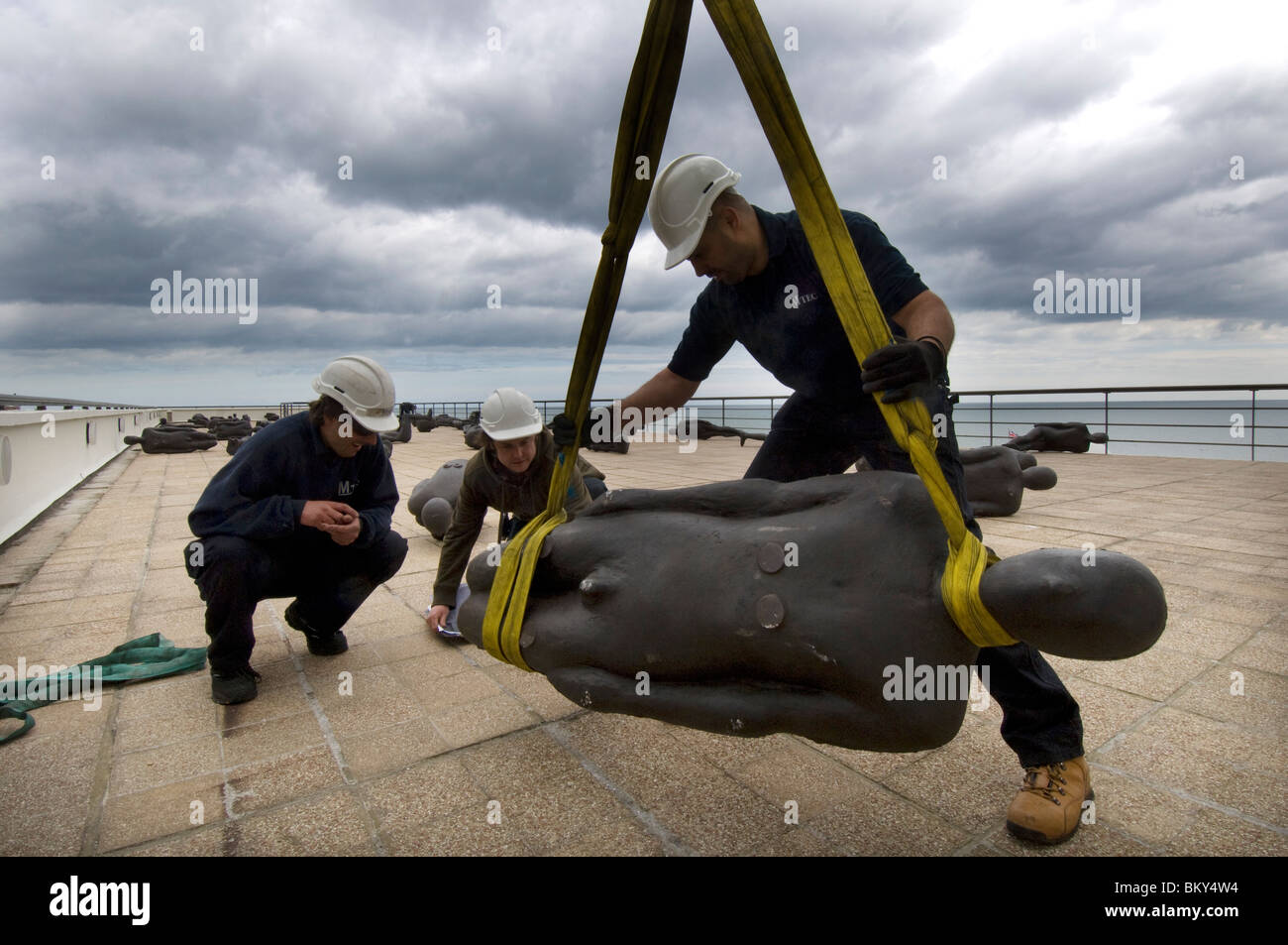 Antony Gormley's 60 'Critical Mass' sculptures being installed on the roof of the Art Deco De La Warr - Stock Image