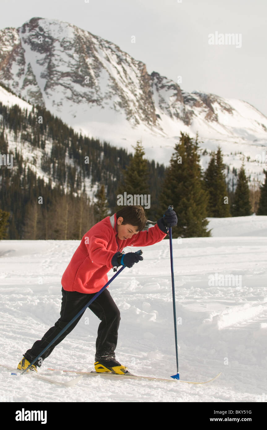 A young boy cross country skiing in the San Juan National Forest, Colorado. - Stock Image
