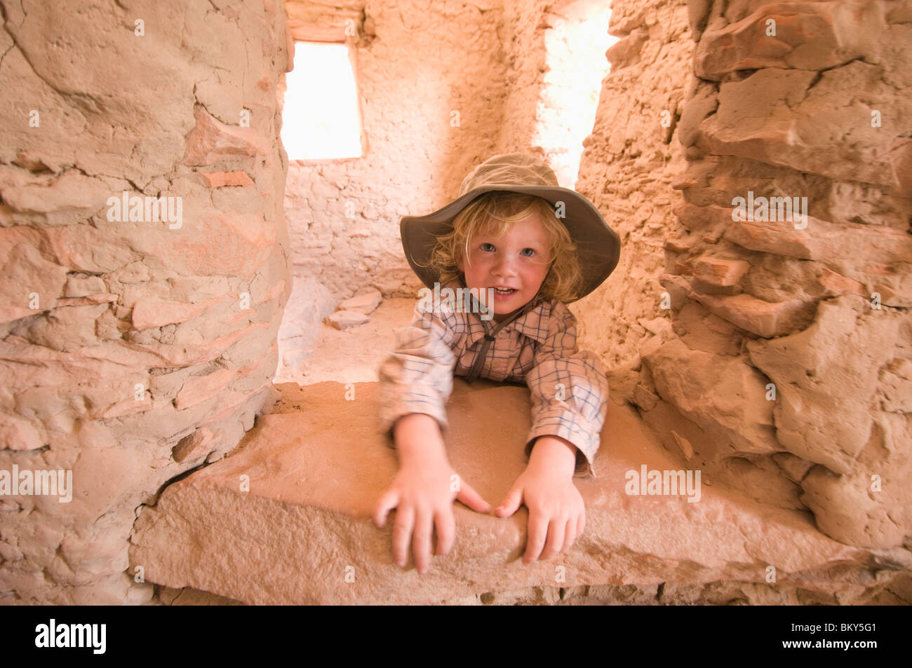 A young boy explores Anasazi Ruin on the San Juan River, Mexican Hat, Utah. - Stock Image
