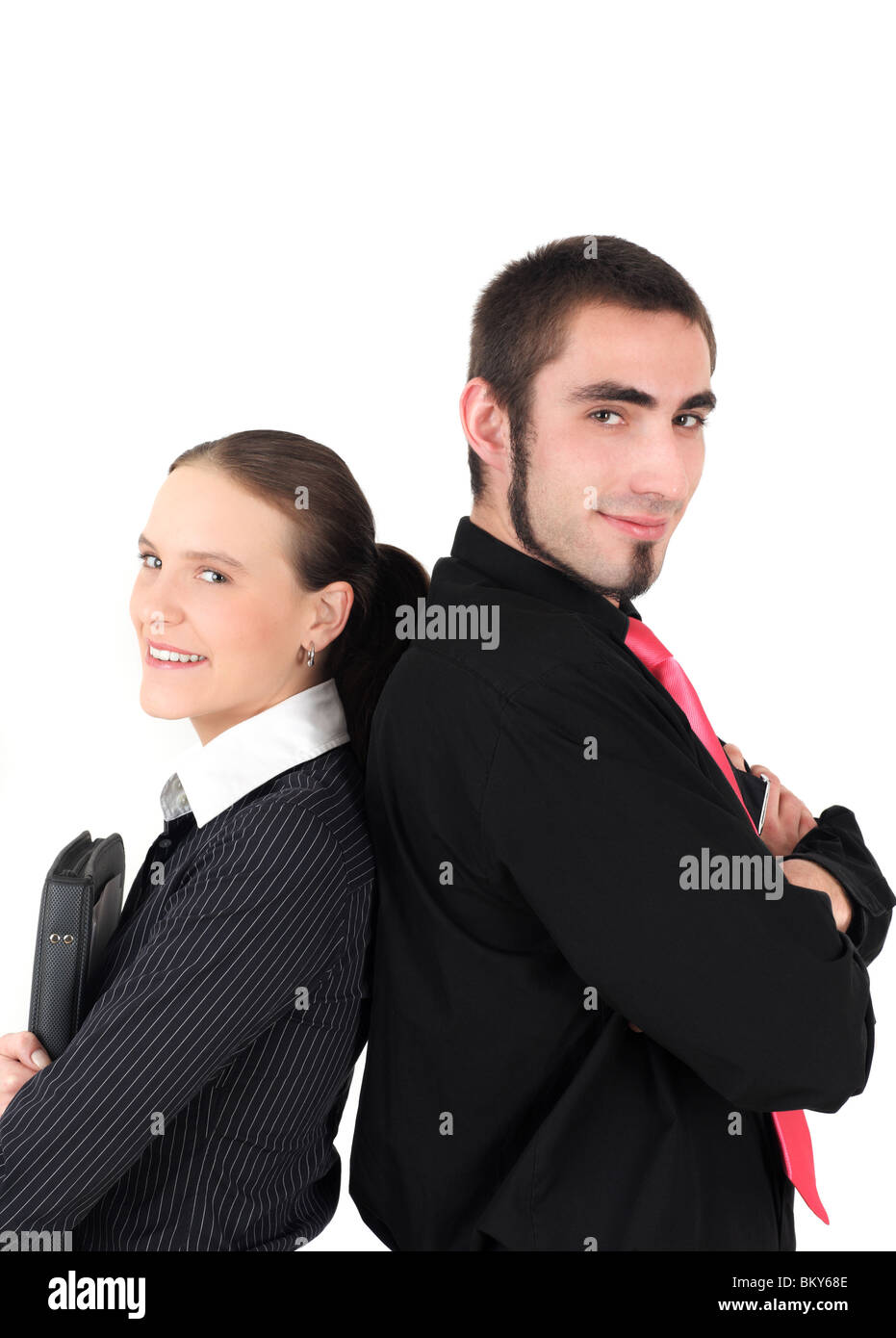 Portrait of businesswoman and businessman back to back, studio shot - Stock Image