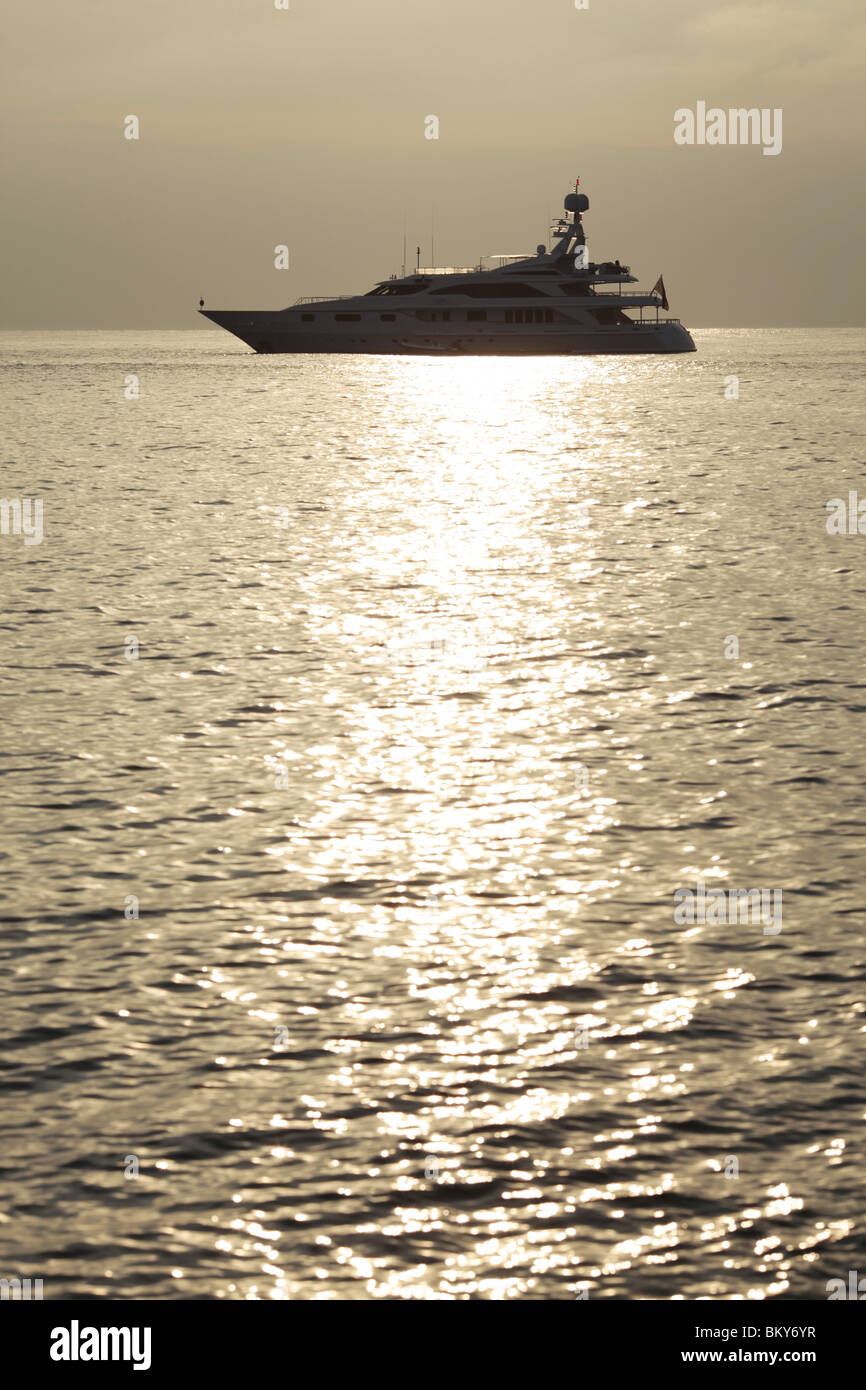 A luxury super yacht moored off the Mediterranean coast of Antibes, Cotes d'Azur, The South of France. - Stock Image