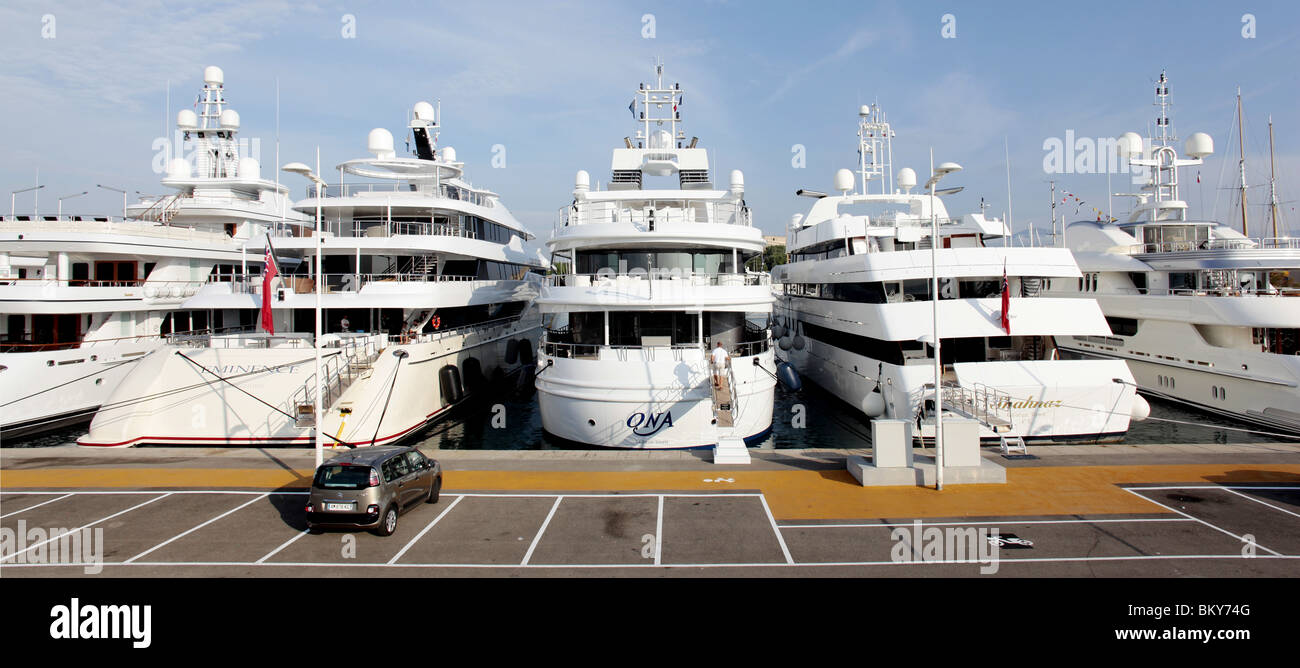 Luxury super yachts moored in Port Vauban, Antibes, France - Stock Image
