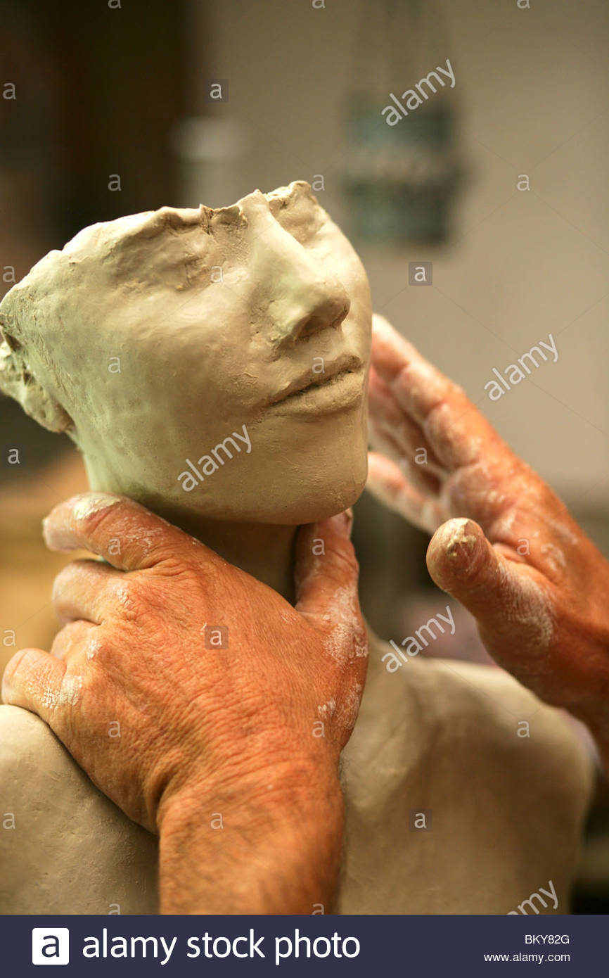 view to the hands of an artist which shape a sculpture from clay, Richard Smith, Aptos, California, USA - Stock Image