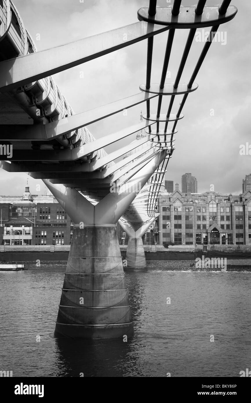 The contemporary Millennium Bridge constructed for the year 2000, London, England. - Stock Image