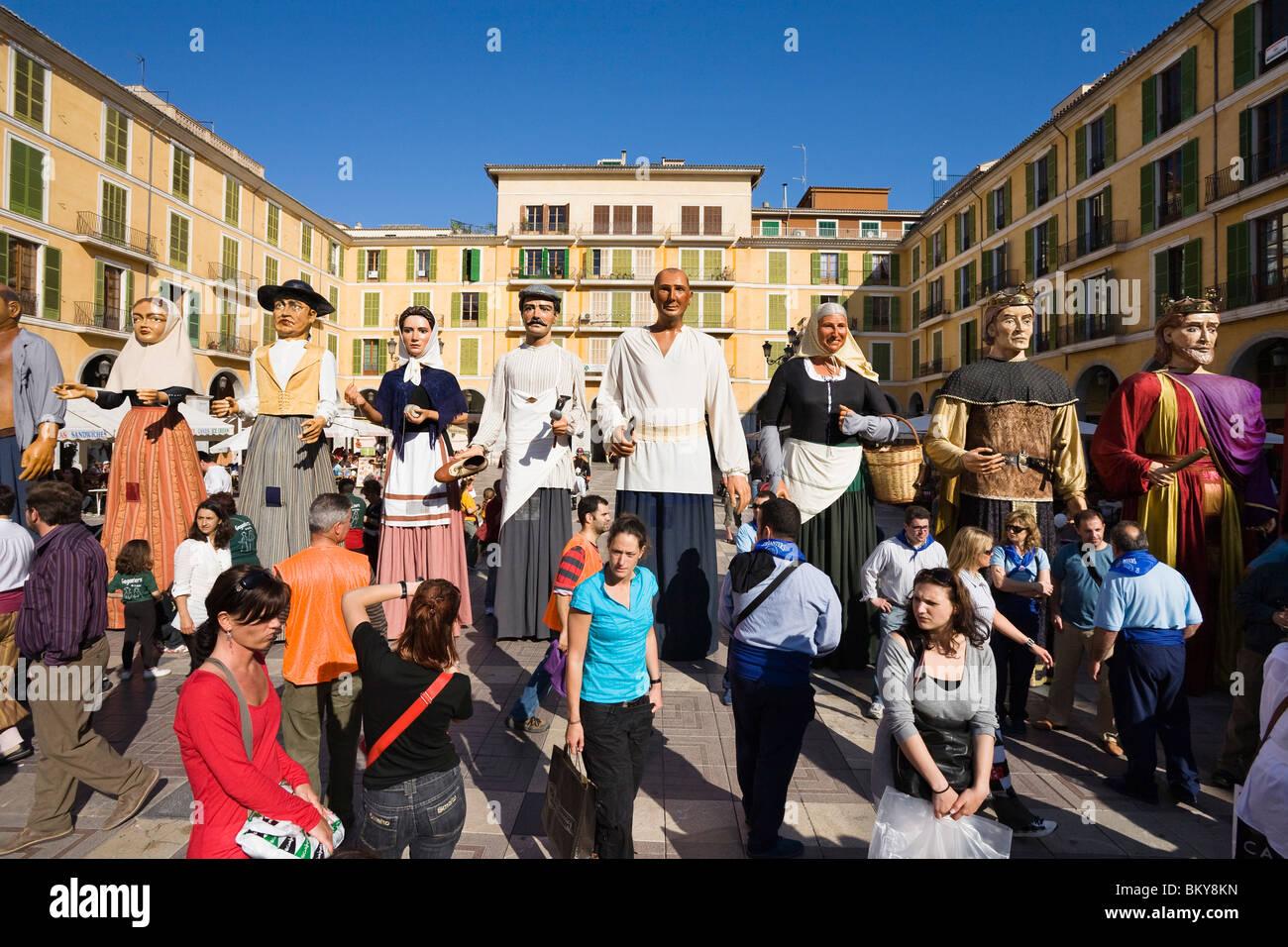 Figures with masks at a square, Diada per la Llengua, Placa Major, Palma, Mallorca, Spain, Europe - Stock Image