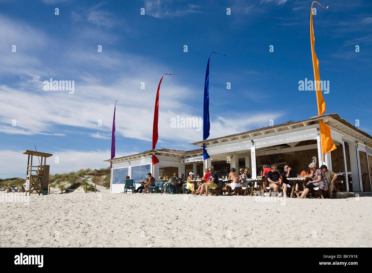 People siting in front of a beach bar at the beach of Es Trenc, Mallorca, Balearic Islands, Spain, Europe - Stock Image