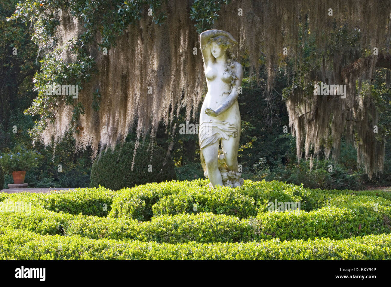 A statue and old oak trees overgrown with spanish moss, Afton Villa Gardens, St. Francisville, Louisiana, USA - Stock Image