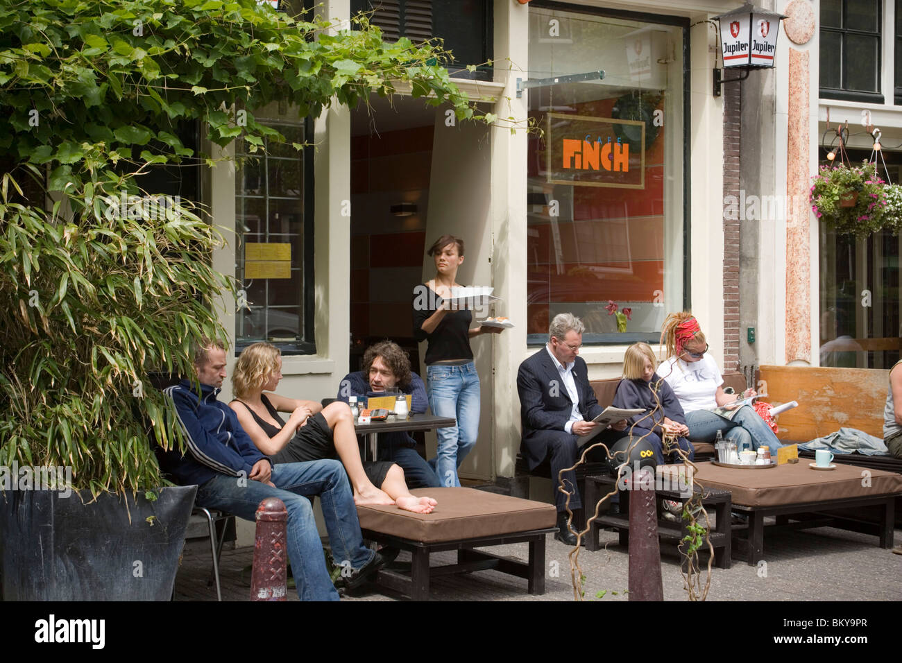 People, Cafe Finch, Jordaan, Waitress serves guests something to eat outside, Cafe Finch, Jordaan, Amsterdam, Holland, - Stock Image